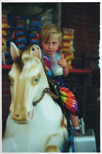 mechanical horse, child on mechanical horse, child on amusement park horse