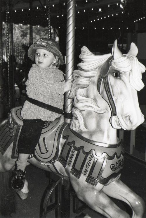 charles carmel, carmel carousel horse, carousel prospect park, child on carousel horse, restored carousel, carmel jumper