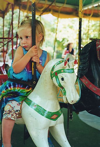 carousel paris france, carousel france, carousel luxembourg, child on small carousel horse, child on paris carousel