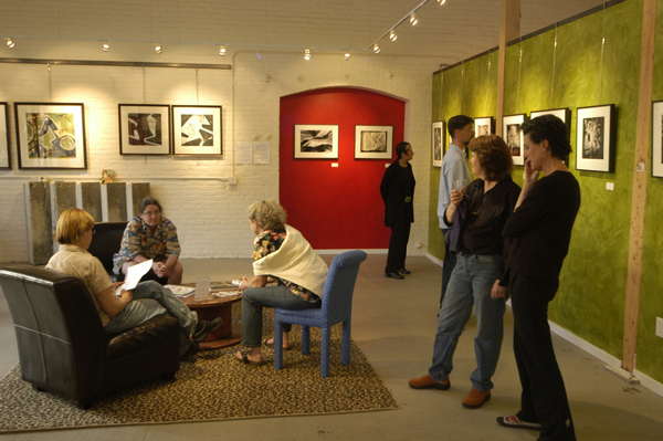 pine street art works, people in art gallery, informal gathering, red wall,