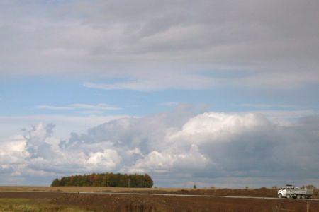 Candian clouds, big clouds, puffy clouds, truck on road, photo liza cowan