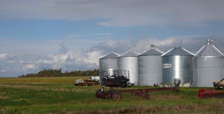 Silos, canada, harvest, hay wagon, puffy clouds, sunlight reflection, farm buildings photo liza cowan