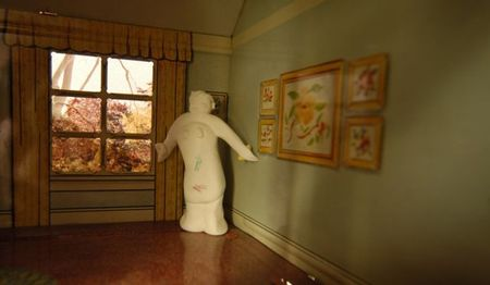 Marx tin house, statue in room
