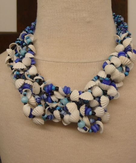 Small equals. necklace by Saada, blue beads white shells. Photo by Liza Cowan