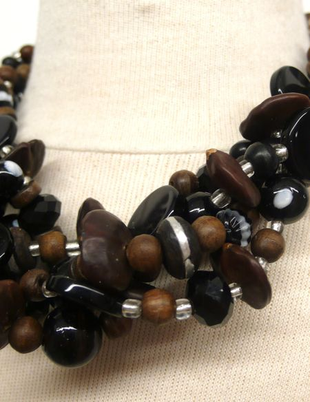 Small equals Necklace by Saada.  ebony,  silver, seeds detail. Photo by Liza Cowan
