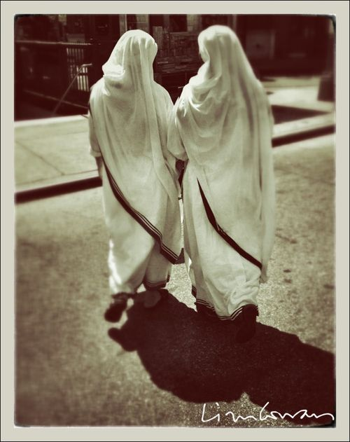 Two Nuns walking across 7th Avenue, NYC 2012 ©Liza Cowan