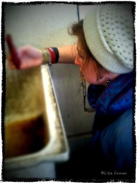 Willa taking picture of utility sink at belgo building in montral photo ©Liza Cowan