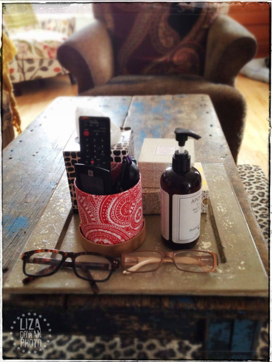 Photo ©Liza Cowan. use a tray or charger  to organize a coffee table.