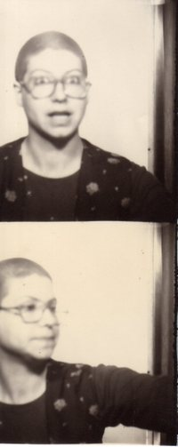 photobooth, girl with crewcut, girl with shaved head, surprised girl, big glasses