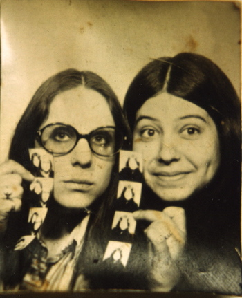 photobooth, teenage girls holding photostrips, 1970's